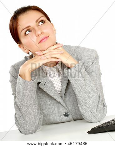 Young businesswoman sitting on the desk. Isolated on white background.