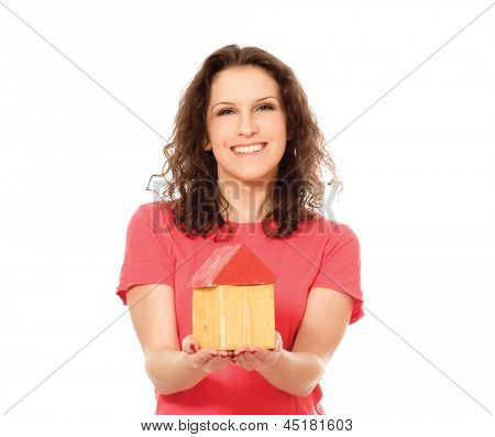 Young woman with toy house isolated on white background