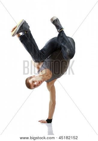 Young handsome fresh man breakdancing with stylish clothes. isolated on white background