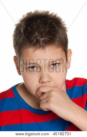 Closeup Portrait Of A Pensive Young Boy