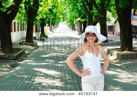 Young Lady Posing On Pave Alley