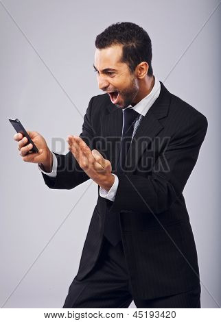 Businessman Screaming In Excitement While Reading Sms