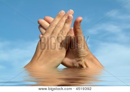 Hands On Water Against Sky