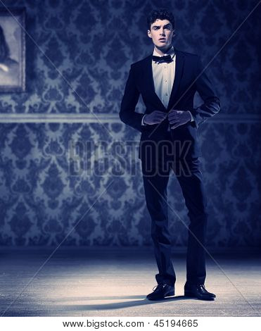Elegant man in dark room