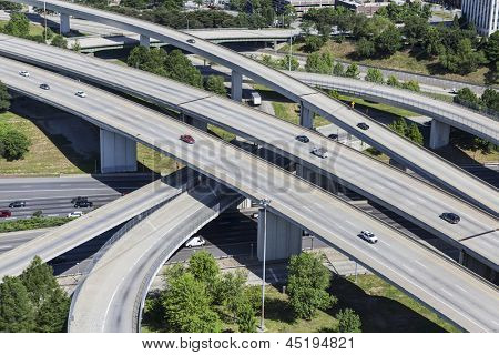 Sprawling suburban freeway interchange aerial in Atlanta Georgia.