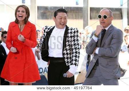 NEW YORK-MAY 3: Korean rapper Psy on stage between Savannah Guthrie and Matt Lauer on the Today Show at Rockefeller Plaza on May 3, 2013 in New York City.