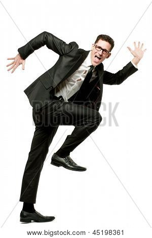 Young happy businessman runs in black suit on white.