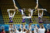 MOSCOW - MAR 24: Boys and girls from cheerleaders team perform stunt at Championship and Contests of