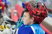 MOSCOW - APR 28: A young hockey player in stylish helmet on closing ceremony of championship season