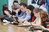 MOSCOW - APRIL 24: Journalists look at laptops on Enlarged meeting of State Council in Grand Kremlin