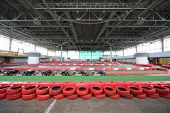 picture of cart  - Empty indoor cart rout with red tires and number of machines for carting - JPG