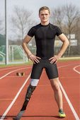 foto of paralympics  - Athlete with handicap stands on a race track - JPG