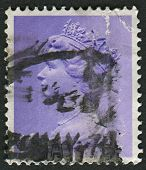 UK-CIRCA 1973:A stamp printed in UK shows image of Elizabeth II is the constitutional monarch of 16
