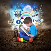 stock photo of formulas  - A young boy is reading a book with school icons such as math formulas animals and nature objects around him for an education concept - JPG