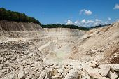 stock photo of crusher  - open tone quarry with excavate - JPG