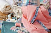 Still life image of sewing basket with pretty pastel fabrics and supplies for home decor or quilting