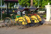 stock photo of rickshaw  - Rickshaw is a close distance transportation in Jogjakarta Indonesia - JPG