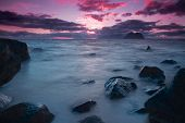 stock photo of lofoten  - Late night midnight sun by the sea on Lofoten islands in Norway - JPG
