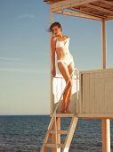 Girl Relaxing In A Beach Gazebo