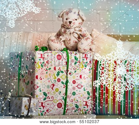 Cute teddy bear with gifts