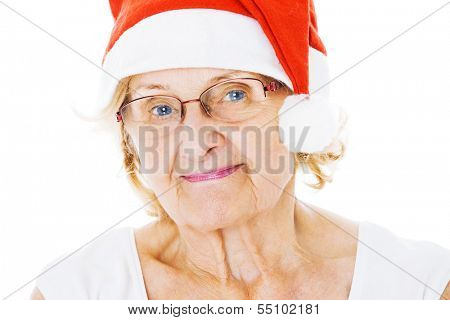 Portrait of senior woman wearing Santa hat isolated over white background
