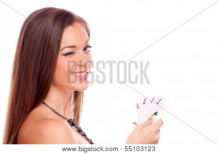 Beautiful brunette holding four aces in her hand and winking - all aces in my hands, isolated on white