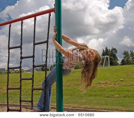 Girl On Playground Equipment