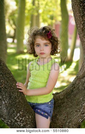 Beautiful Blue Eyes Little Girl In The Park Tree