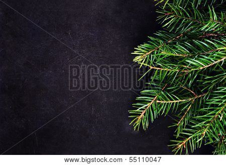 Christmas Tree Branch On Blackboard With Copy Space For Greeting Text. Vintage Christmas Card With D