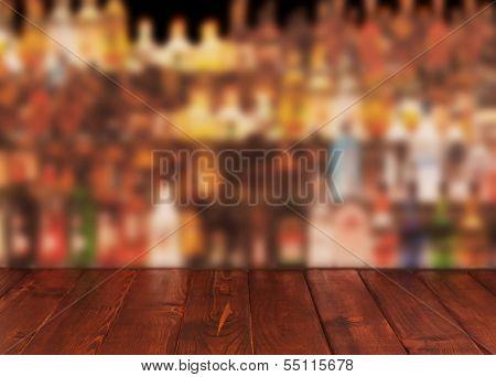 Dark wooden table against interior of bar