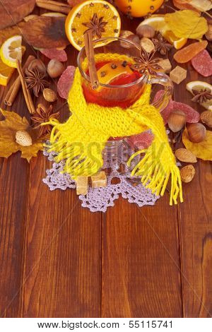 Glass of mulled wine in yellow scarf
