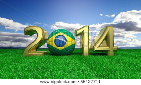 Gold 2014 with Brazilian soccer ball on grass and blue sky
