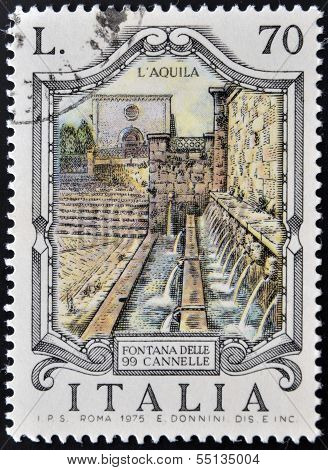 ITALY - CIRCA 1975: stamp printed in Italy shows Fountain of the 99 faucets in Aquila circa 1975