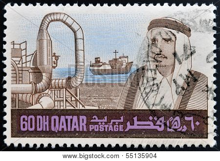 stamp printed in Qatar shows a portrait of Sheikh Khalifa bin Hamed Al-Thani and industry