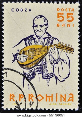 stamp shows portrait of traditional musician playing on cobza folk instrument of the lute family