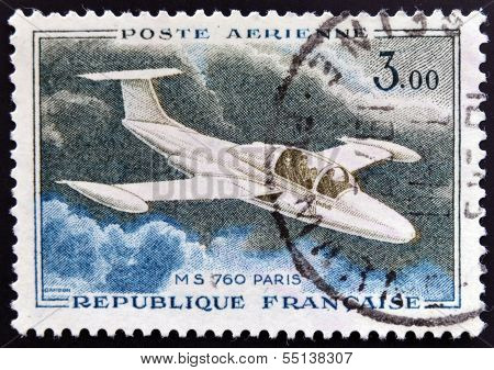 A stamp printed in France shows image of a Morane-Saulnierthe glider MS 760 Paris