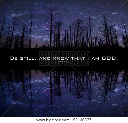 Star-filled skies in a night image in the forest. Reflections in pond foreground. Encouraging bible scripture from Psalm 46:10 in the middle.