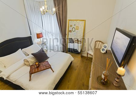 Modern luxury bedroom with LCD television /  Hotel Room