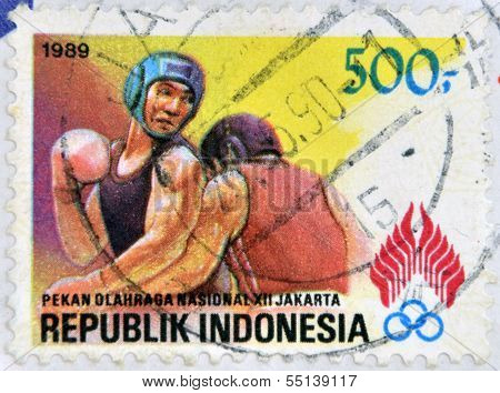 REPUBLIK INDONESIA - CIRCA 1989: A stamp printed in Indonesia dedicated to the Boxing circa 1989.