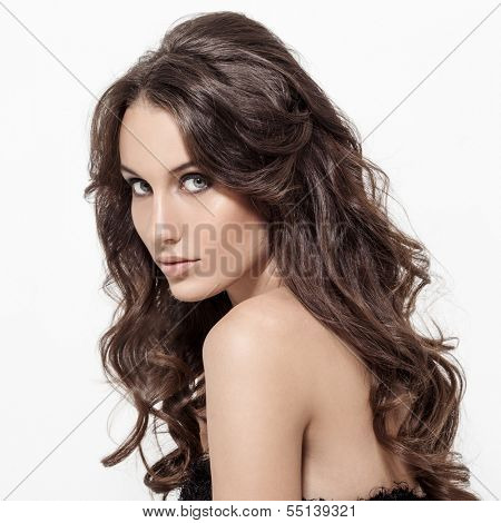 Beautiful Brunette Woman. Curly Long Hair.
