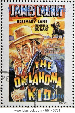 A stamp printed in Sao Tome shows movie poster The oklahoma kid