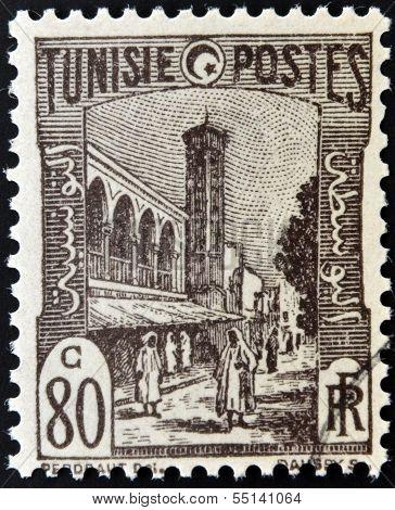 TUNISIA - CIRCA 1923: stamp printed in Tunisia shows Mosque and street Tunis circa 1923
