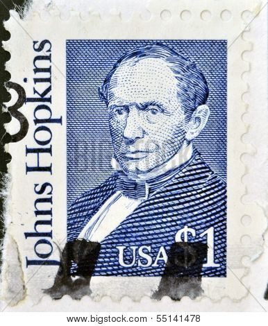 stamp printed in USA shows Johns Hopkins was a wealthy American entrepreneur philanthropist