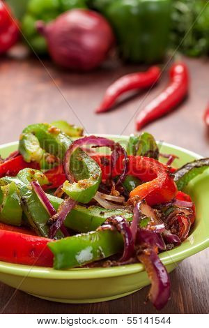 plate with traditional mexican food fajita peppers and ingredients on a table