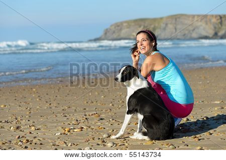 Sporty Woman And Dog On Beach