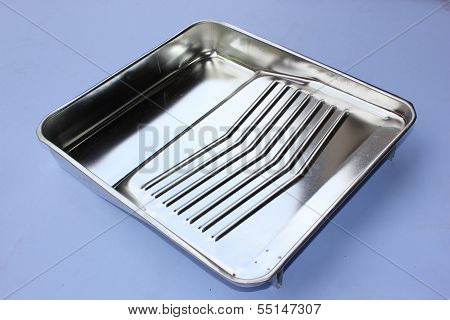 A decorators industrial metal paint tray