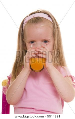 Little Girl With Glass Of Juice.