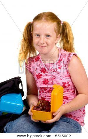 Schoolgirl Is Having Grapes As Lunch