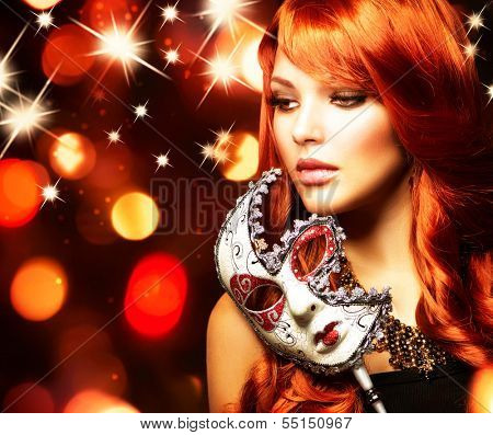 Beautiful Woman with the Carnival mask. Holiday Fashion Girl Portrait. Beauty Hairstyle and Makeup. Make up. Celebrating Glamorous Lady over Glowing Background