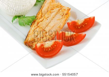 chinook steak and cheese on white plate with tomatoes